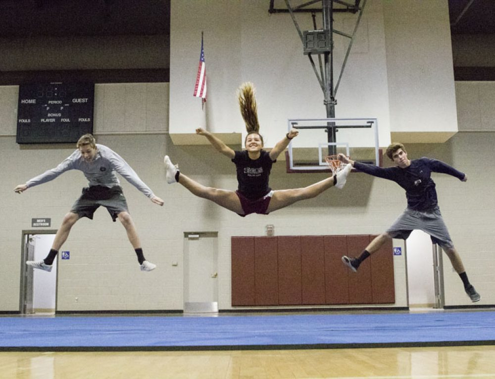 Behind the Bow: Journalists join cheer practice, share experience