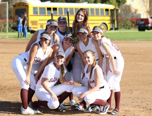 Senior softball players lead team through encouragement, example